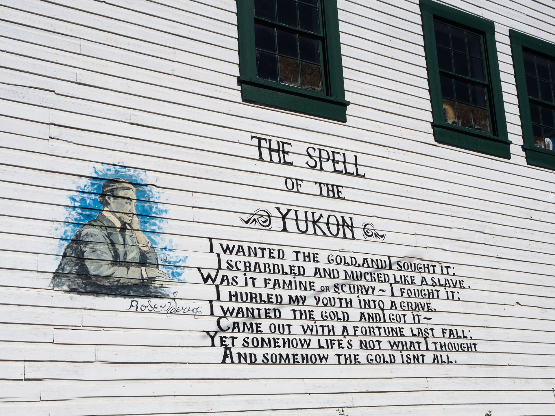 'The spell of the Yukon' poem on a building in Dawson City