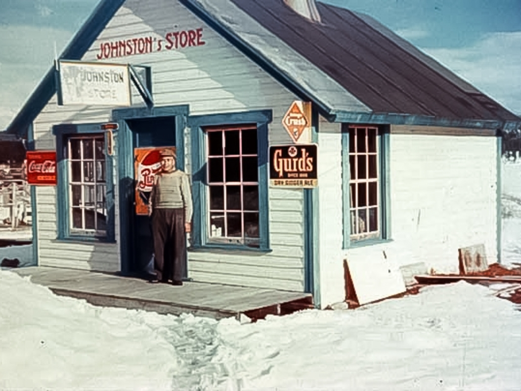 George Johnston standing in front of his Teslin store