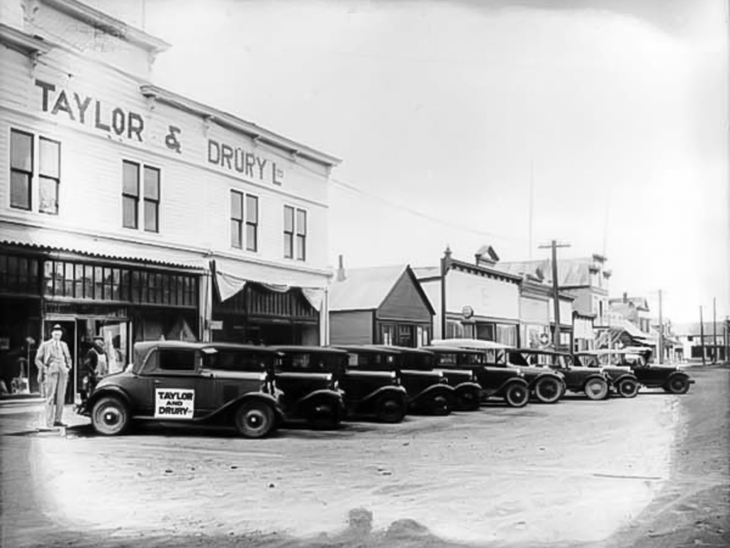 Cars for sale outside Taylor and Drury Store in Whitehorse 1928