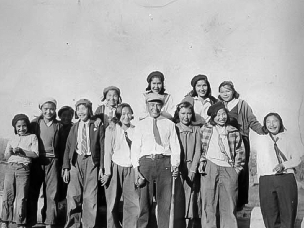 George Johnston with girls' baseball team at church picnic 1941